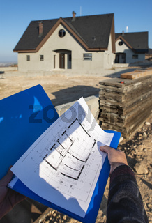 New build house and blueprints