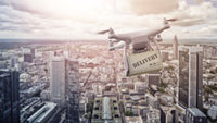multicopter drone with package over Frankfurt am Main