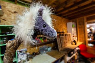 Hairy purple horse in a jewelry workshop