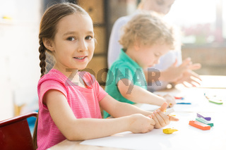 Cute Little Girl in Craft Class