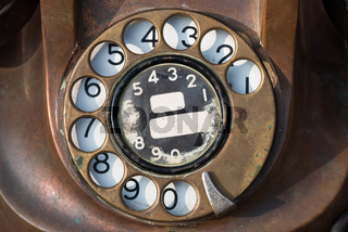 old brown antique rotary style telephone