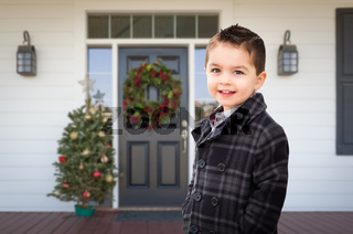 Young Mixed Race Boy On Front Porch of House with Christmas Decorations