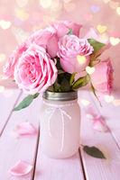 Lush pink roses in a vintage jar