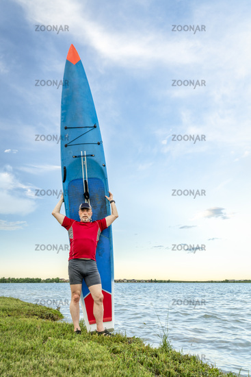 Senior paddler with his stand up paddleboard