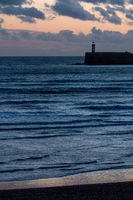 Newhaven Lighthouse and Seaford Beach at sunset