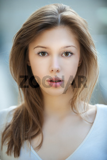 Portrait of young beautiful woman with long hair