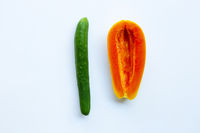 Cucumber and papaya on white background. Sex concept