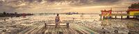 Tourist sitting at Yeoh jetty, Penang, Malaysia. Panorama