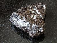 piece of Hematite (Kidney Ore) stone on black
