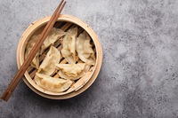 Asian dumplings in bamboo steamer