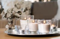 burning fragrance candles on table at cozy home