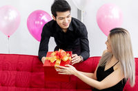 Couple with new year gift box
