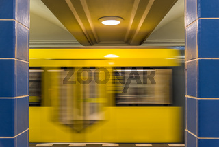The yellow subway in the blue subway station