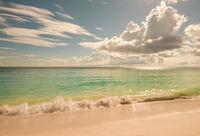 Retro style image of tropical island beach