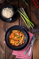 colorful turkey fricassee with asparagus and paprika