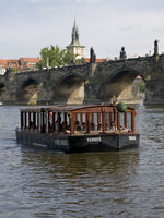 Tourists boat in the river Prague