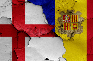 flags of England and Andorra painted on cracked wall