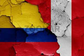 flags of Colombia and Peru painted on cracked wall