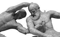 Antique statue of warrior killing beard amn by sword. ancient sculpture of gladiators