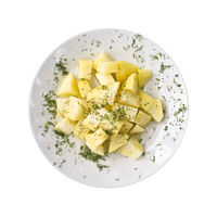 Sliced boiled potatoes on a plate, isolated on white background. Top view.