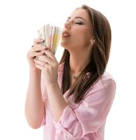 Financial well-being concept. Woman with money