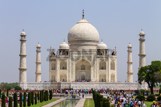 Panorama of Taj Mahal with walkway, garden square, reflecting pool and visitors. UNESCO World Heritage in Agra, India