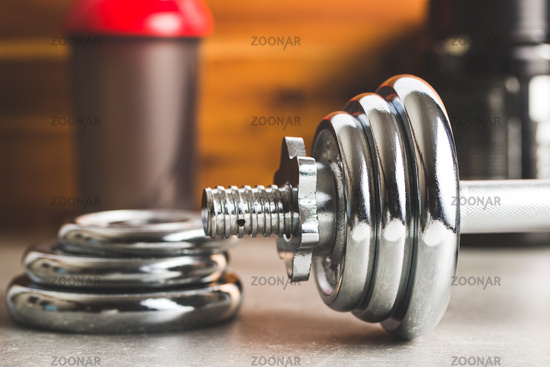 The chrome dumbbell and weight.
