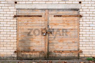 Garage door with padlock and hinges