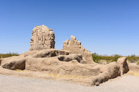 Small outer building structure with head carvings at the Casa Grande Ruins in Arizona.