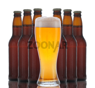 Glass of Beer with Bottles Behind