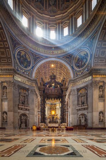 Sun beams inside St. Peter's Basilica, Vatican City, Rome, Italy