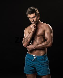 Muscular man thinking