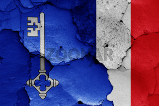 flags of Cluny and France painted on cracked wall