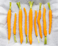 carrots on baking parchment prepared for grilling