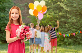 red haired girl with flowers at birthday party