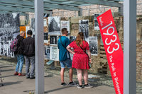 People at the Topography of Terror (German: Topographie des Terrors) outdoor  exhibition  at the Berlin Wall