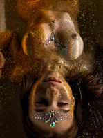 Beautiful girl in gold glitter high angle shot
