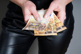 woman holding three fifty euro banknotes or bills in her hands