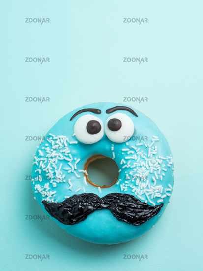Blue glazed donut with mustache flying