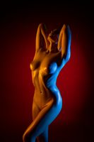 Naked woman cropped shot in color lights