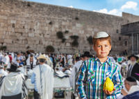 People in white Taliths pray