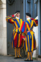 Swiss Guard on St. Peter's Square at St. Peter's Basilica in Vatican City in Rome Italy