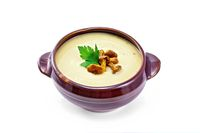 Soup-puree mushroom with chanterelles in clay bowl