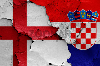 flags of England and Croatia painted on cracked wall