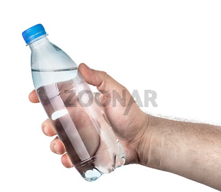 Closed plastic water bottle in hand