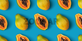Papaya fruit seamless pattern on blue color background