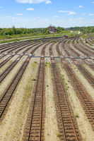 Empty freight railway yard with many tracks and operations control tower