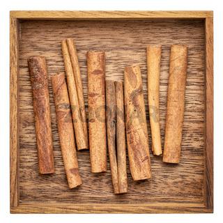 cinnamon sticks in a wooden box