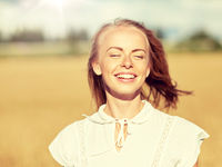 smiling young woman in white on cereal field