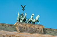 Top of  Brandenburger Tor - Berlin landmark isoalted on blue sky
